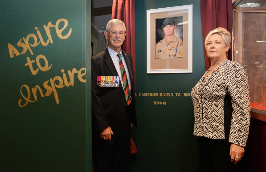 THE CORPORAL'S WORDS: Doug and Kaye Baird stand at the enterance to the Corporal Cameron Stewart Baird VC MG room.
